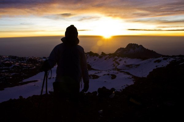 Watching the sunrise at the Kilimanjaro Summit