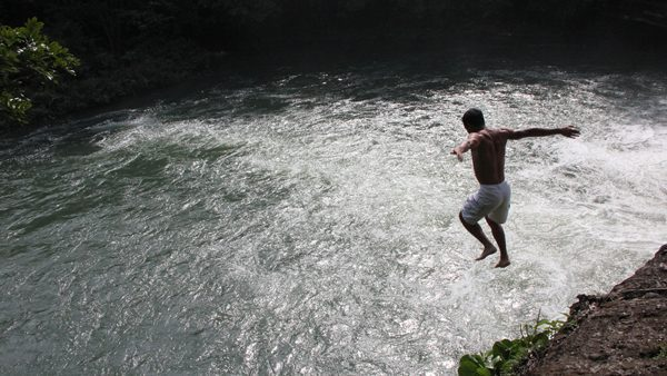 Jumping to the river in Belize