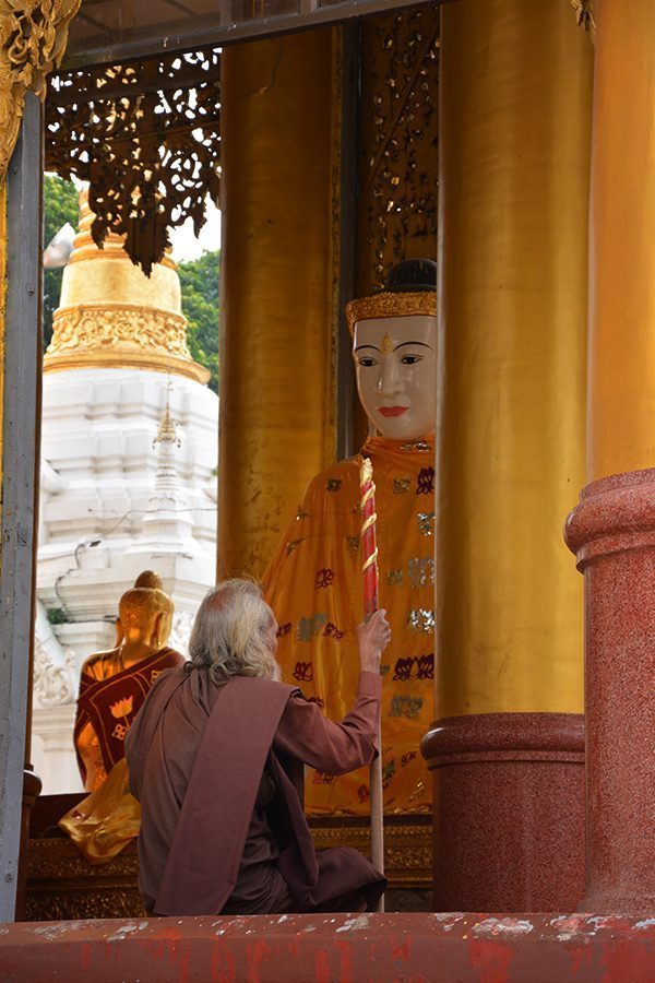 Man sitting at Shwedagon Pagoda in Yangon, Myanmar