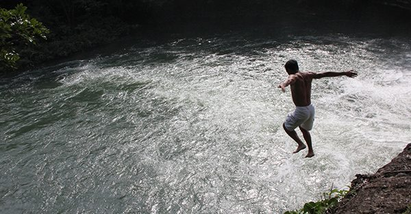 Jumping in Rio Blanco, Belize