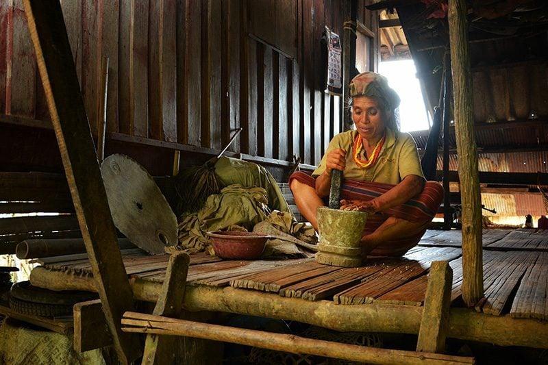 Lady making pig food in Mae Sariang, Thailand