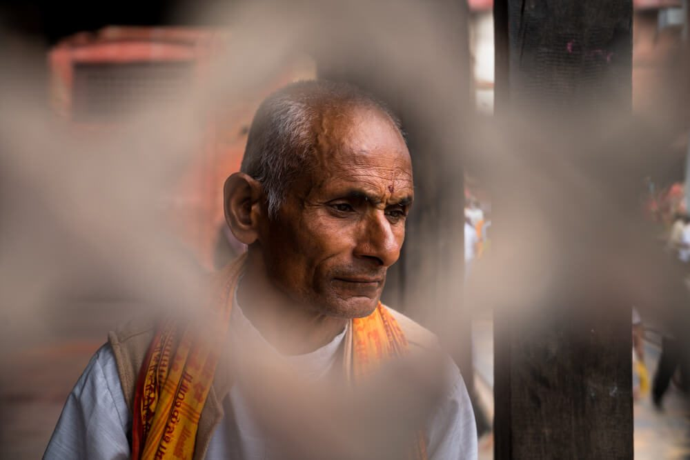 A man reading scriptures at Pashupatinath