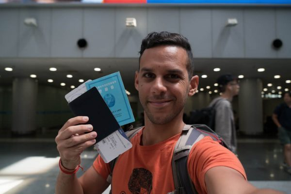With my passport, visa and boarding pass to North Korea