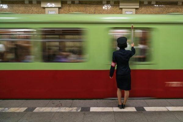 Female train conductor in Pyongyang Metro, North Korea