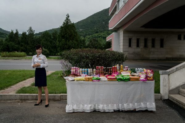 Lady selling on the street, North Korea