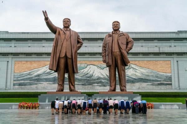 Bowing at Mansudae Grand Monument in Pyongyang, North Korea
