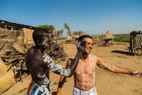 Getting painted by the Karo tribe