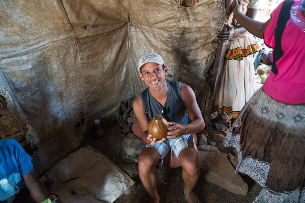 Norbert drinking beer at Konso Market in Ethiopia