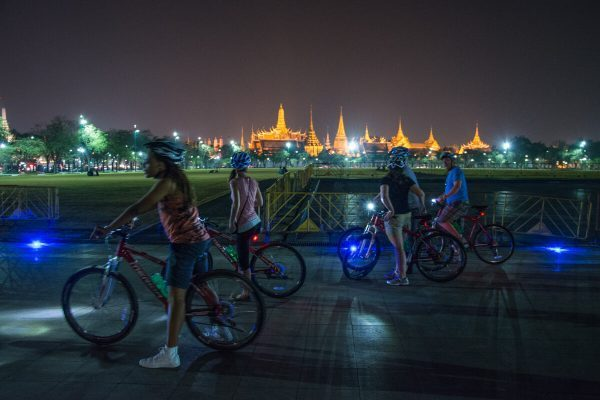 Biking in front of Bangkok's grand palace