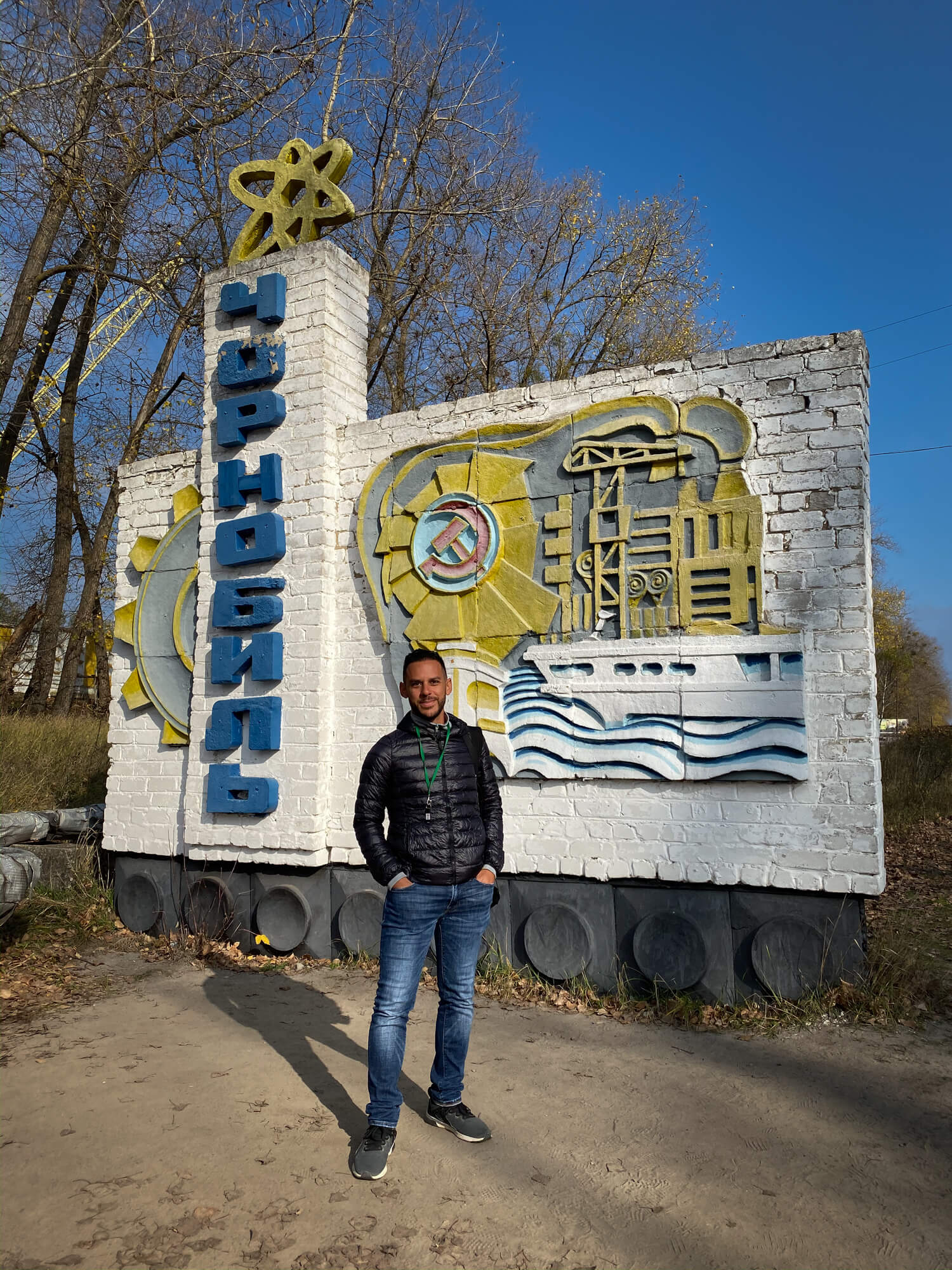 Standing at the Chernobyl Sign