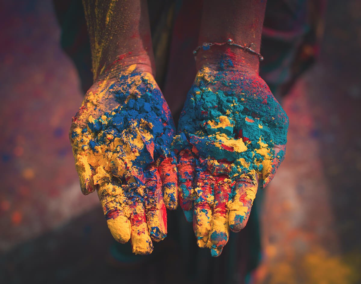 Hands with Holi colorful powders