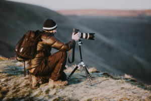 Photographer with backpack in the outdoors