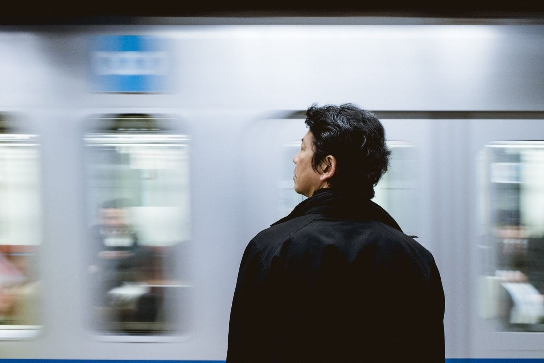 Japanese Man waiting for the JR train
