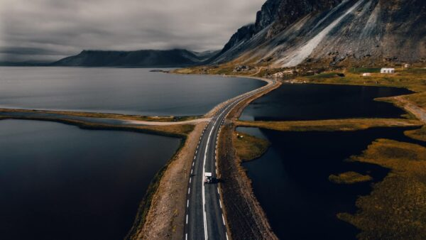 Aerial view of a road and a car